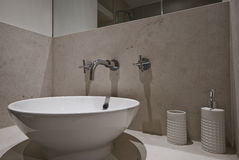 Ceramic bathroom sink. Contemporary ceramic bathroom sink close up shot Royalty Free Stock Images
