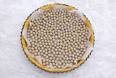 Ceramic beans in an uncooked pie crust Stock Image