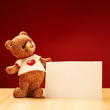 Ceramic bear statuette next to a greeting card Stock Photography
