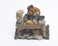 Ceramic bear working at desk Stock Image
