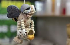 Ceramic bee figurine in a honey store royalty free stock images