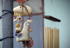 Ceramic bell with chicken figure. Stock Image