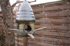 Ceramic birdhouse with birdseed royalty free stock photo