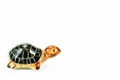 Ceramic black turtle on white background Royalty Free Stock Images