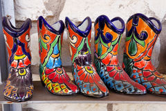 Ceramic boots from Mexico. Ceramic boots imported from Mexico at a roadside souvenir shop in Texas Royalty Free Stock Image