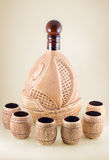 Ceramic bottle. The ceramic bottle and six wineglasses are photographed close-up Stock Image