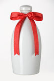 Ceramic bottle with red riband Stock Photography