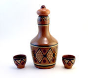 Ceramic bottle with small ceramic cups. Covered with ornament Stock Photo