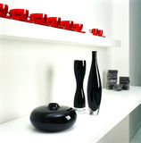Ceramic bottles and cups. Display of ceramic bottles and red cups (Film scanned Royalty Free Stock Image