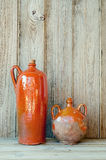 Ceramic Bottles. Two old pottery bottles on a wooden plank background Stock Photo