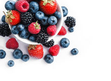 Ceramic bowl with blueberries, strawberries and blackberries Royalty Free Stock Image