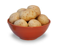 Ceramic bowl with boiled potatoes in their skins isolated Royalty Free Stock Photography