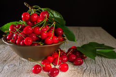 Ceramic bowl with cherries on a wooden background Stock Images