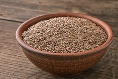 Ceramic bowl filled with flax seeds.  royalty free stock photography