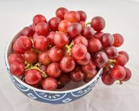 Ceramic bowl of fresh red grapes Stock Photos