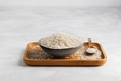 Ceramic bowl of healthy food with parboiled rice on on gray concrete background. royalty free stock photography