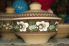 Ceramic bowl. With a lid ornamented national pattern Royalty Free Stock Photography