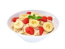 Ceramic Bowl Of Oatmeal Porridge With Banana And Strawberry  Isolated. Delicious And Healthy Food For Breakfast Royalty Free Stock Photos