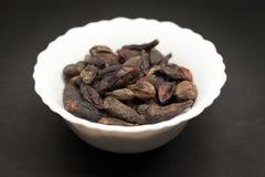 Ceramic bowl of Organic Chebulic Myrobalan. Royalty Free Stock Photo