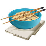 Ceramic bowl with rice in it. Ceramic bowl stands on the gray napkin. There is a rice in the bowl and on the bowl lay brown Chinese chopsticks Royalty Free Stock Images