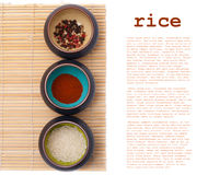 Ceramic bowls with spices and rice Stock Images
