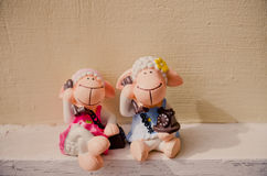 Ceramic boy and girl sheep doll for the home decor. Ceramic boy and girl sheep doll put on shelf for the home decor royalty free stock images