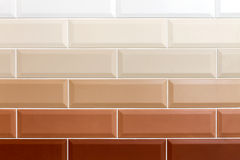 Ceramic brick wall. Background in the form of bricks. Ceramic brick tiles. Gradient color. Close-up Royalty Free Stock Images