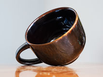 Ceramic brown cup Stock Photography