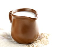 Ceramic brown  jug full of milk Royalty Free Stock Photography