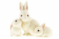 Ceramic bunny family isolated on a white background. Stock Image