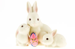 Ceramic bunny family isolated on a white background. Royalty Free Stock Photography