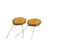 Ceramic Capacitors. Electronic components, ceramic capacitors laying arocss each other Royalty Free Stock Photography