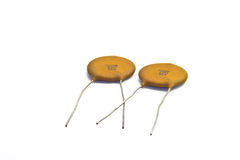 Ceramic Capacitors. Electronic components, ceramic capacitors laying arocss each other Royalty Free Stock Photos