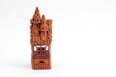 Ceramic caste. Ceramic castle. Small brown statuette Stock Photo