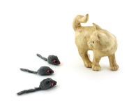 Ceramic cat looking at furry gray mice royalty free stock photos