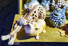 Ceramic cat and pig at sale during Riga Christmas market. Ceramic pig and cat statues presented for sale at the Christmas market in Riga, Latvia. At the fair Royalty Free Stock Images