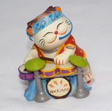 Ceramic Cat Playing Drums Royalty Free Stock Images