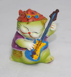 Ceramic Cat Playing Guitar. Ceramic cat ornament playing guitar Royalty Free Stock Photography