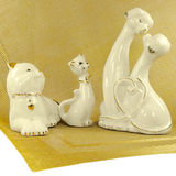Ceramic cats and dogs, figurines standing on a napkin Royalty Free Stock Photos