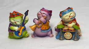 Ceramic Cats Playing Instruments Stock Photo