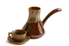 Ceramic cezve and coffee cup. Over white Royalty Free Stock Photos
