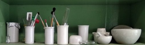 Ceramic chemical glassware for experiments on the shelf Stock Photo