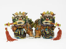 Ceramic Chinese Lions with Swords Stock Images
