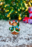 Ceramic Christmas toy elk in festive clothes standing in the sno Royalty Free Stock Image