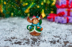 Ceramic Christmas toy elk in festive clothes standing in the sno Stock Photo