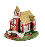 Ceramic Church. Small ceramic church with sign in front on white background Royalty Free Stock Photo