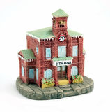 Ceramic City Hall. Small ceramic city hall building with clock on white background Stock Photo