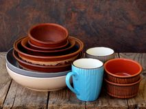 Ceramic, clay empty handmade bowl, dishes and cup on wooden background. Different pottery earthenware utensil, kitchenware. Stock Image