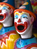 Ceramic Clowns. A line of ceramic clowns with their mouths wide open at a carnival stock photos
