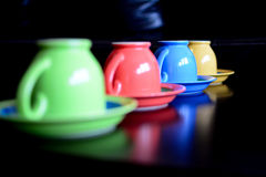 Ceramic coffe cups. Four ceramic cups in vibrant colors royalty free stock image